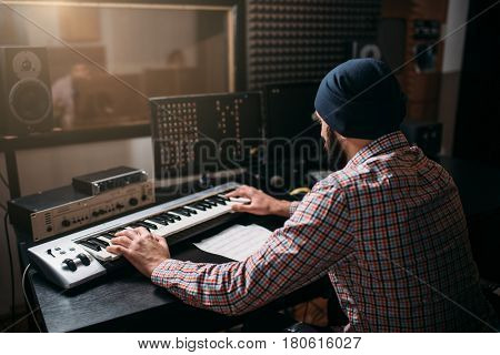 Sound producer work with audio equipment in studio
