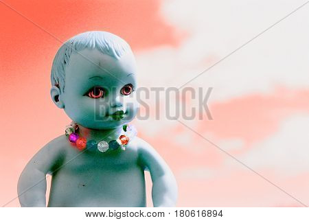 Concept picture of a baby doll that looks like the demon