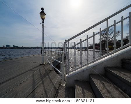 boat landing-stage with old white lantern at the Binnenalster Hamburg Germany