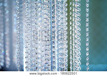 Decoration crystal chandelier background in cool colors lots of glitter
