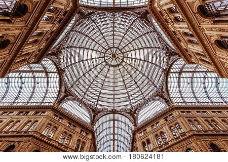 NAPLES, ITALY - MAY 13, 2014: Galleria Umberto I. This is a public shopping gallery. Bottom view up.