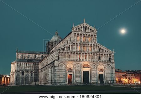 Cathedral at Piazza dei Miracoli (or Square of Miracles) in Pisa Italy at dusk with moon
