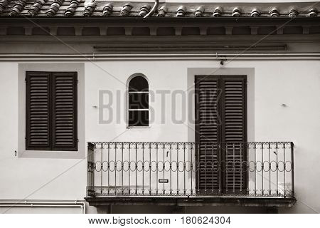 Balcony with decoration in Medieval Town Lucca in Italy.