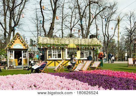 Springtime at Tivoli gardens with thousands of hyacinths on the lawn. People enjoying the sunshine. Copenhagen Denmark - April 6 2017