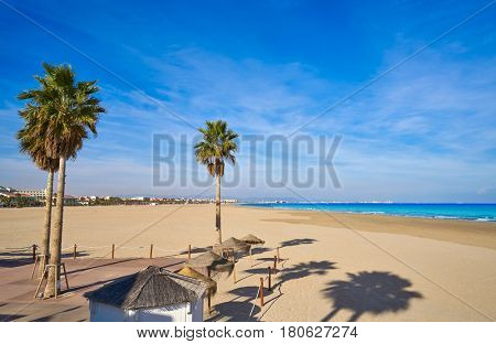 Valencia La Malvarrosa beach arenas palm trees in Spain