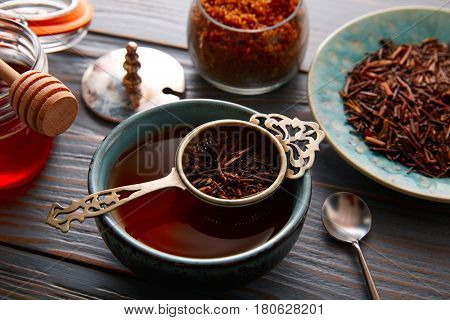 kukicha tea served in bowl on wooden table board