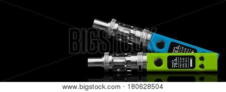 Two electronic cigarettes - isolated on black background.