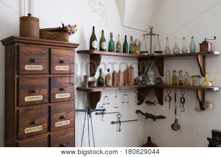 Grodno, Belarus - April 5, 2017: Shelf With Medieval Drugs And Old Apothecary Cabinet In The Pharmac