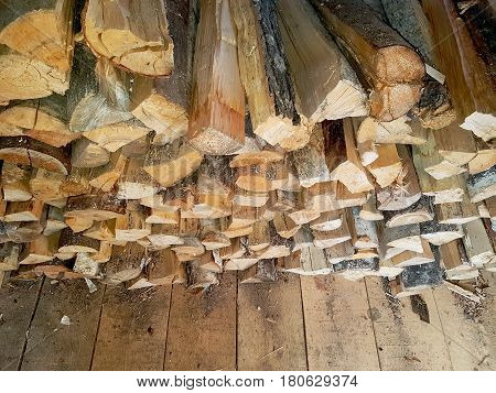 Stack of birch and aspen wood in a barn