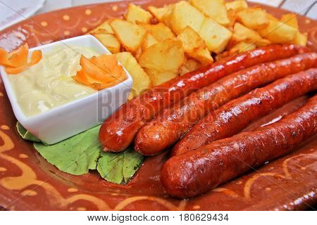 Serbian sausage and potatoes in a dish