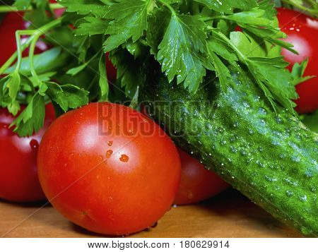 The fresh vegetables on the wooden table close up