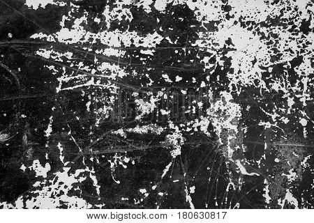 Old grunge painted wall with abrasion marks black and white abstract texture background