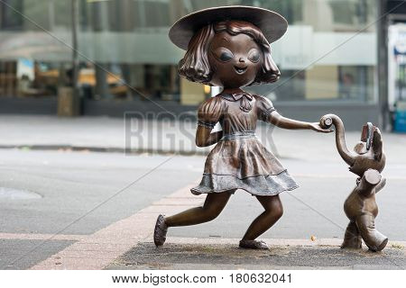 Auckland New Zealand - March 1 2017: Bronze statue of dancing girl with elephant named Twist by the artist Tanja Jade McMillan. Misery is another name. On Pitt Street.