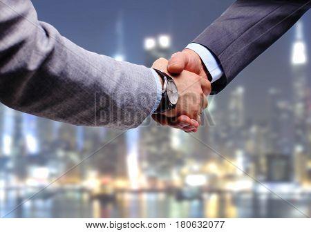 Business handshake. Businessman and businesswoman shaking hands.