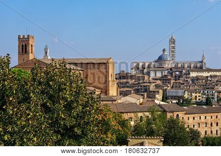 The view of the Basilica di San Domenico and the Cathedral Duomo from the Medici Fortress - Siena, Italy