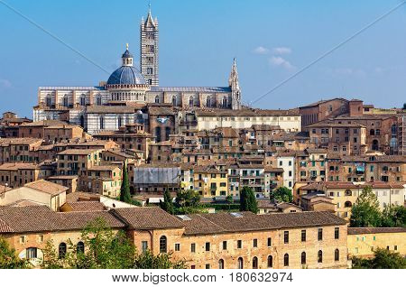 The view of the Cathedral Duomo of Siena and the surrounding houses from the Medici Fortress - Siena, Italy