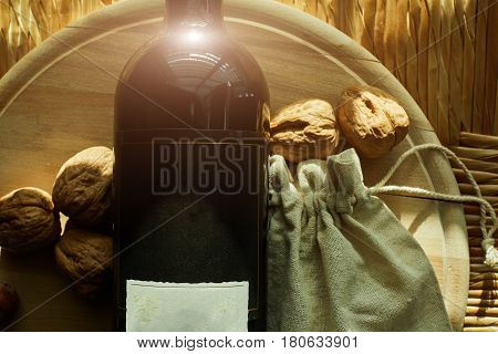 Passover holiday concept with wine, matzoh and seder plate over dark background
