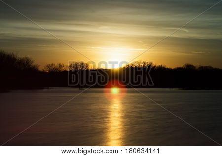 Golden sunrise over a lake near the Des Moines river