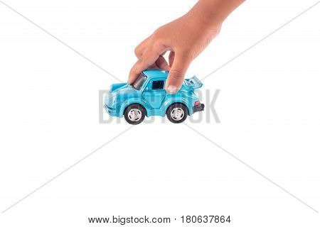 Hand little boy play toy blue car on road isolate