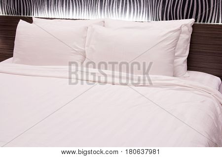 white pillow on the bed at hotel