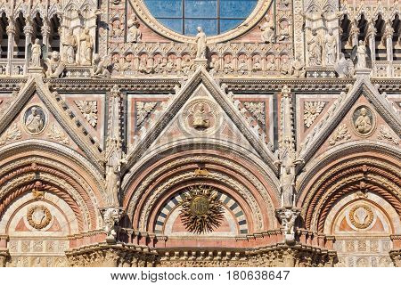 The beautiful marble West facade of the Cathedral Duomo in Siena, Italy