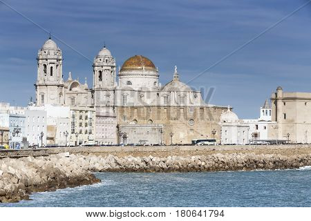Panoramic view of the city on March bordered by the Mediterranean sea and its Cathedral called Catedral Nueva by locals in the background take in Cadiz Andalusia Spain