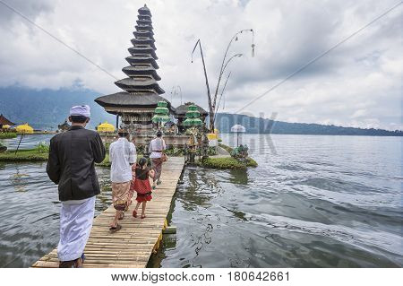 BALI, INDONESIA - March 24, 2017. Pura Ulun Danu Bratan, is a Shivaite and water temple on Bali. This temple is used for offerings ceremony to the Balinese water, lake and river goddess Dewi Danu.