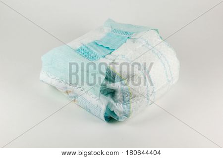 Full baby diaper on a white background