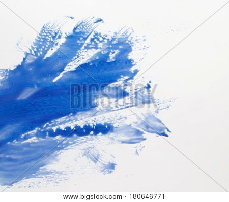 Creative abstract art, modern painting. Smeared blue color strokes on white background, water, stream. Abstractionism, creativity
