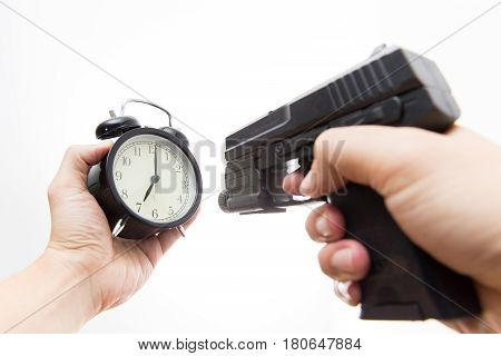 Kill time Gun shooting clock with male hand.
