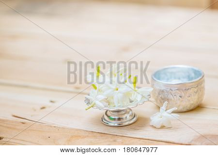 Thailand Songkran festival decoration concept water in silver bowl with jasmine white flower.