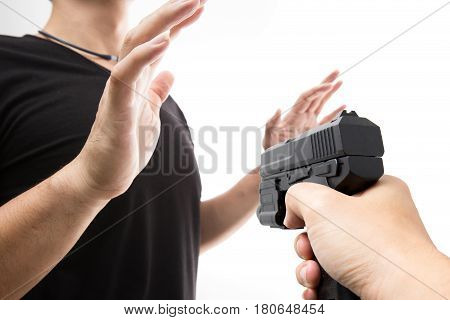 Robber With A Gun Robbing Intimidate A Man Surrender. Isolated White Background. Bandit Steals From