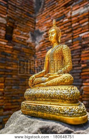 Golden Buddha image on rock in Ayuthaya historical park
