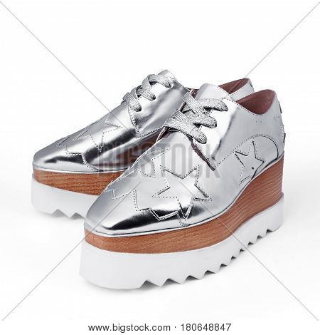 stylish female silver shoes in white background