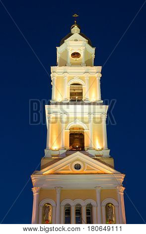 Bell tower in evening illumination Holy Trinity Seraphim-Diveevo Convent in village Diveevo Russia