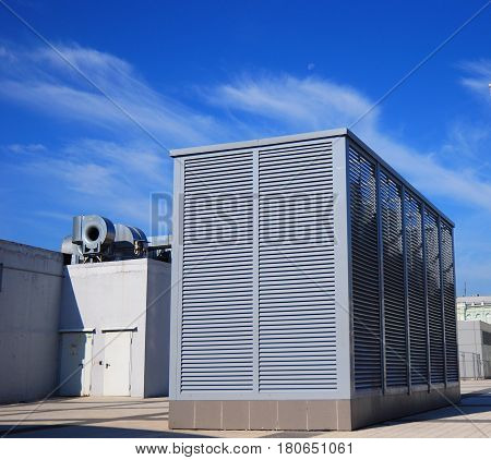 Industrial air conditioning and ventilation systems on the street against cloudy sky. Ventilation system of factory outdoor