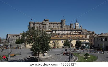 BRACCIANO ITALY - MARCH 11 2017: People under the Orsini-Odescalchi 15th century Castle is the main monument in town