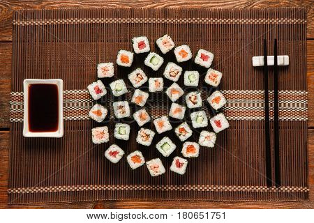 Japanese delicious great sushi set served on brown straw mat, flat lay. Traditional and healthy seafood cuisine, food art, restaurant menu photo.