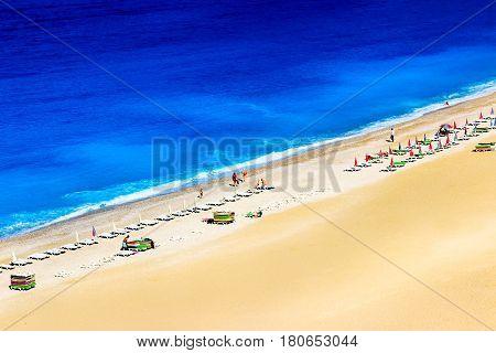 Turkey, the Mediterranean Sea, Oludeniz, Blue lagoon  Beach - June 2016: people rest on the beach on the Mediterranean coast.