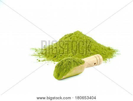 Tea powder in wood tea scoop on white background.