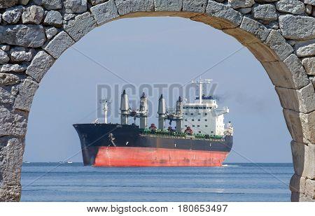 Empty bulk carrier cargo ship with deck cranes