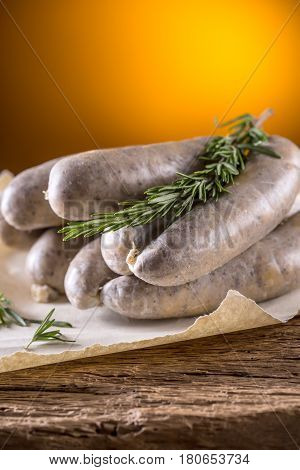 Sausages. Raw pork sausages on oak wooden table.