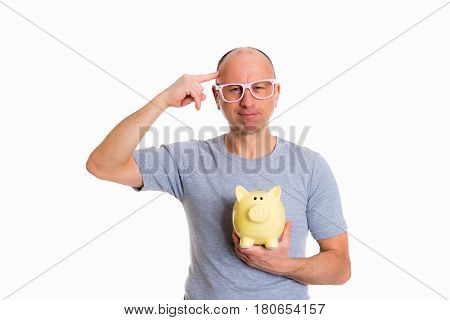 Man In Gray Shirt With Pink Glasses And Piggybank Show A Bird