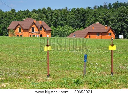 Free Land with Natural Gas Pipelines Ready for Install on the Summer Cottage Village Background. Make Gas Line Connections From Steel or Copper Pipes to Ranges Clothes Dryers Safe and Secure.
