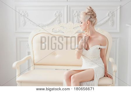 beautiful sexy woman in luxury interior glamour fashion. gorgeous blonde girl in hotel. vogue style fashion woman in trendy evening dress. Beauty and jewelry model. Rich woman at retro villa. Vintage