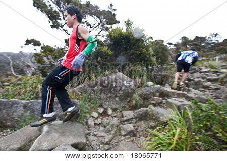 MT KINABALU, SABAH - OCT 25: Participant  running down Mt Kinabalu in the International Climbathon held on October 25, 2009 in Mt Kinabalu, Sabah, Malaysia.