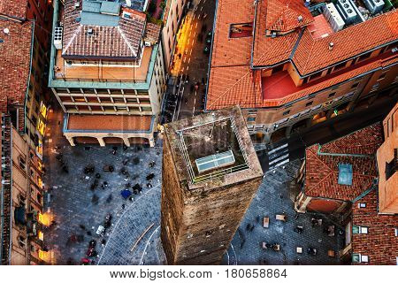 Bologna, Italy. Aerial view of Bologna, Italy with one tower. City life in the historical city center with people and old buildings - cafes, bars, restaurants