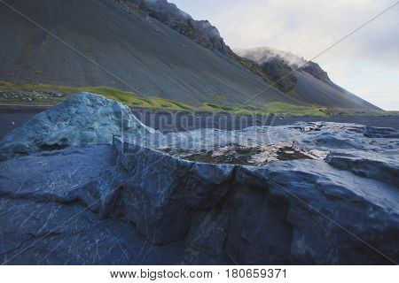 Beautiful vibrant landscape of volcanic black sand beach in Iceland