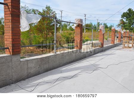Building a Metal and Concrete Bricks Fence with Iron Bar Framework