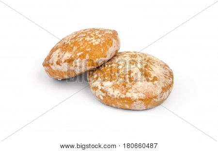 Two cookies raisin cookies on a white background